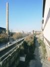 Veduta da via Borgaro del complesso delle Ferriere: sulla destra l'area Vitali e sulla sinistra l'area Ingest. Fotografia di Filippo Gallino per Settore Riassetto Urbano, Città di Torino, dicembre 2001.
