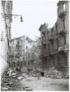 """Via Goffredo Casalis ang. Via Duchessa Jolanda, """"N. 23-[...]= 1 bomba da 500 Ibs. […] ed 1 bomba da 1000 Ibs […] = scoppio sul tetto bomba. Effetti prodotti dai bombardamenti dell'incursione aerea del 20-21 novembre 1942. UPA 2009D_9B04-37. © Archivio Storico della Città di Torino"""