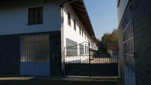 Cancello di ingresso dal lato sud-ovest della cascina Spinetta. Fotografia di Edoardo Vigo, 2012