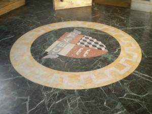 L'atrio degli ex uffici Ceat con il logo a pavimento. Fotografia di Giuseppe Beraudo, 2009