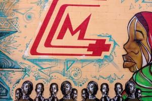 Artisti vari, dettaglio del murale Sorrisi di madri africane, 2013. Fotografia di Roberto Cortese, 2017 © Archivio Storico della Città di Torino
