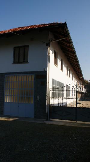 Cancello di ingresso dal lato sud-ovest della cascina Spinetta. Fotografia di Edoardo Vigo, 2012.