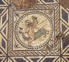 Particolare del pannello figurato (emblema) centrale con un amorino alato che cavalca un delfino, © Soprintendenza per i Beni Archeologici del Piemonte e del Museo Antichità Egizie.
