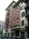 Edificio a uso abitazione e negozi in via Campana 1