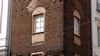 Basamento rustico della nuova Torre civicaall'angolo delle vie Milano e Corte d'Appello. Fotografia di Plinio Martelli, 2010. © MuseoTorino