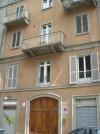 Edificio di civile abitazione già falegnameria e magazzino in via Susa 4