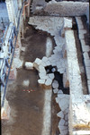 Un tratto del basolato della strada dietro al teatro venuto alla luce durante i lavori di sistemazione dell'area del Duomo, © Soprintendenza per i Beni Archeologici del Piemonte e del Museo Antichità Egizie.