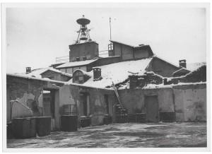 Piazza Palazzo di Città. Palazzo del Municipio. Effetti prodotti dai bombardamenti dell'incursione aerea dell'8 dicembre 1942. UPA 2632_9C03-54. © Archivio Storico della Città di Torino