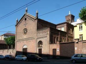 Edificio a uso abitazione e carrozzeria in via Genova 8