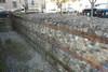 Un tratto del muro romano conservato in via Egidi, © Soprintendenza per i Beni Archeologici del Piemonte e del Museo Antichità Egizie.